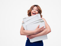 Cheerful businesswoman holding folders Royalty Free Stock Image