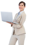 Cheerful businesswoman holding laptop Royalty Free Stock Photos
