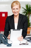 Cheerful businesswoman holding tablet pc Stock Images