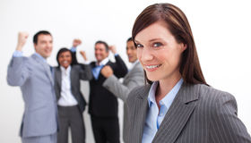 Cheerful businesswoman leading her team Stock Photography