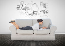 Cheerful businesswoman lying on couch Stock Images