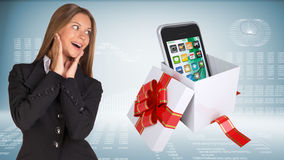 Cheerful businesswoman and open gift boxe with Stock Image