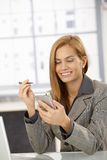 Cheerful businesswoman with PDA Stock Images