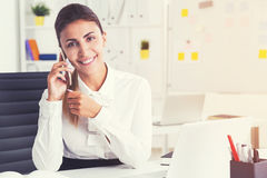 Cheerful businesswoman on the phone Stock Images