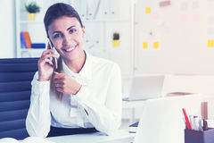 Cheerful businesswoman on the phone, toned Stock Photography