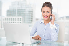Cheerful businesswoman phoning Stock Photo