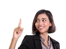 Cheerful businesswoman pointing finger up Royalty Free Stock Image