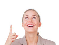 Cheerful businesswoman pointing upward Royalty Free Stock Images
