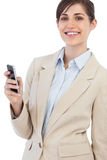 Cheerful businesswoman posing with phone on right hand Stock Images