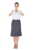 Cheerful businesswoman posing thumbs up Royalty Free Stock Photos
