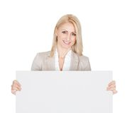 Cheerful businesswoman presenting empty board Stock Photography