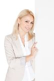 Cheerful businesswoman presenting empty board Royalty Free Stock Image