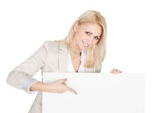 Cheerful businesswoman presenting empty board Stock Images