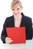 Cheerful businesswoman with a red clipboard Royalty Free Stock Images