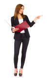 Cheerful businesswoman with ring binder pointing at empty space. Stock Photography