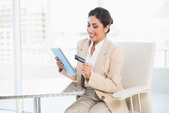 Cheerful businesswoman shopping online with tablet pc Royalty Free Stock Photo