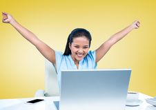 Cheerful businesswoman sitting with her arms raised on office desk Stock Photo