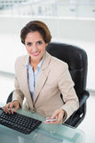 Cheerful businesswoman smiling at camera Stock Images