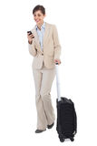 Cheerful businesswoman with suitcase and phone Stock Photos