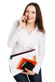 Cheerful businesswoman talking over a mobile phone Royalty Free Stock Image