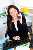 Cheerful businesswoman talking on phone Royalty Free Stock Images