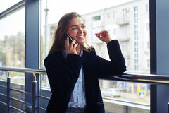 Cheerful businesswoman talking on the phone Royalty Free Stock Image
