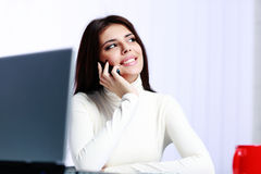 Cheerful businesswoman talking on the phone at office Royalty Free Stock Photo
