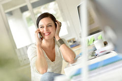 Cheerful businesswoman talking on phone Royalty Free Stock Image
