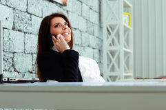 Cheerful businesswoman talking on the phone Stock Image