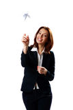 Cheerful businesswoman throwing paper plane Stock Photos