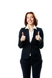 Cheerful businesswoman with thumbs up Stock Photo
