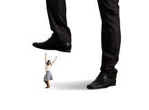Cheerful businesswoman under big leg Stock Images