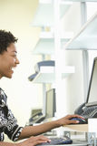 Cheerful Businesswoman Using Computer In Office Royalty Free Stock Image