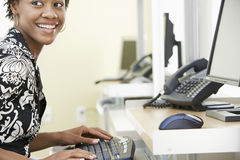 Cheerful Businesswoman Using Computer In Office Royalty Free Stock Photography