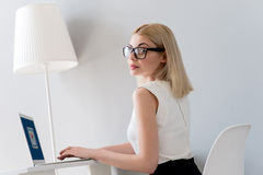 Cheerful businesswoman is using computer for work Royalty Free Stock Image