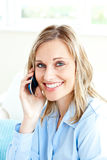 Cheerful businesswoman using her cellphone at home Stock Image