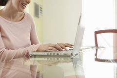 Cheerful Businesswoman Using Laptop At Table Stock Image