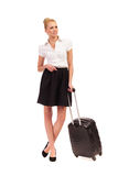 Cheerful Businesswoman waiting with suitcase. Royalty Free Stock Image