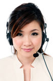 Cheerful businesswoman wearing headphones royalty free stock images