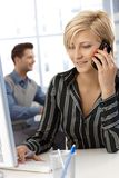 Cheerful businesswoman working Stock Photo