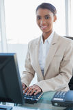 Cheerful businesswoman working on her computer Royalty Free Stock Photos