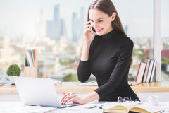 Free Cheerful Businesswoman Working In Office Stock Images - 77212464