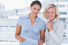 Cheerful businesswomen holding digital tablet Stock Image