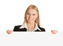 Cheerful businesswomen presenting empty board Royalty Free Stock Photo