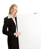 Cheerful businesswomen presenting empty board Stock Photo