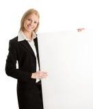 Cheerful businesswomen presenting empty board Stock Photo