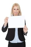 Cheerful businesswomen presenting empty board Royalty Free Stock Photography