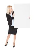 Cheerful businesswomen presenting empty board Royalty Free Stock Images