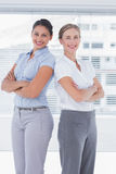 Cheerful businesswomen standing back to back Royalty Free Stock Photo