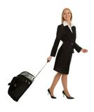 Cheerful businesswomen with travel bag Stock Photo
